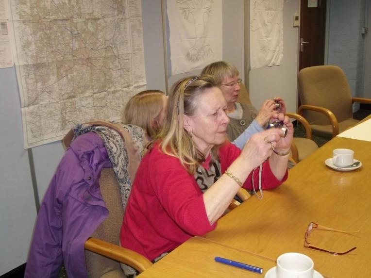 Checking digital cameras at workshop